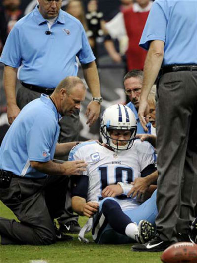 Tennessee Titans quarterback Jake Locker &#40;10&#41; is helped off the field after being sacked by Houston Texans strong safety Glover Quin in the first quarter of an NFL football game Sunday, Sept. 30, 2012, in Houston. &#40;AP Photo&#47;Dave Einsel&#41; <span class=meta>(Photo&#47;Pat Sullivan)</span>