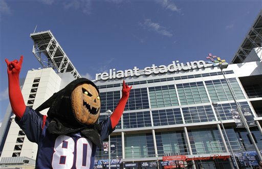 A fan in a pumpkin mask arrives at Reliant Stadium before an NFL football game between the Houston Texans and the Baltimore Ravens Sunday, Oct. 21, 2012, in Houston. &#40;AP Photo&#47;Patric Schneider&#41; <span class=meta>(AP Photo&#47; Patric Schneider)</span>