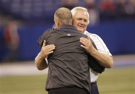 Indianapolis Colts head coach Chuck Pagano is hugged by Houston Texans Wade Phillips before during the first half of an NFL football game Sunday, Dec. 30, 2012, in Indianapolis. (AP Photo/AJ Mast)
