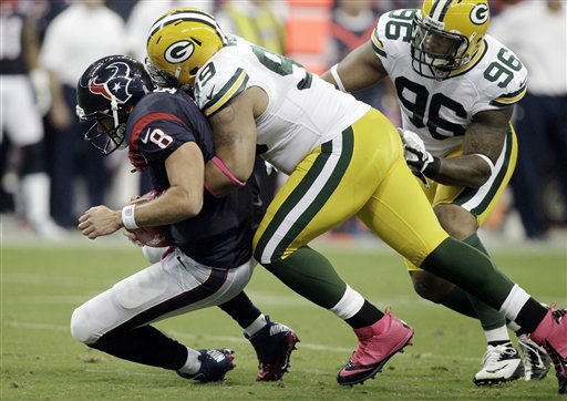 Houston Texans&#39; quarterback Matt Schaub &#40;8&#41; is sacked by Green Bay Packers defensive end Jerel Worthy &#40;99&#41; in the first quarter of an NFL football game Sunday, Oct. 14, 2012 in Houston. &#40;AP Photo&#47;Patric Schneider&#41; <span class=meta>(AP Photo&#47; Patric Schneider)</span>