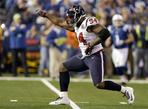 Houston Texans&#39; Antonio Smith &#40;94&#41; reacts following a play during the first half of an NFL football game against the Indianapolis Colts, Sunday, Dec. 30, 2012, in Indianapolis. &#40;AP Photo&#47;Michael Conroy&#41; <span class=meta>(AP Photo&#47; Michael Conroy)</span>