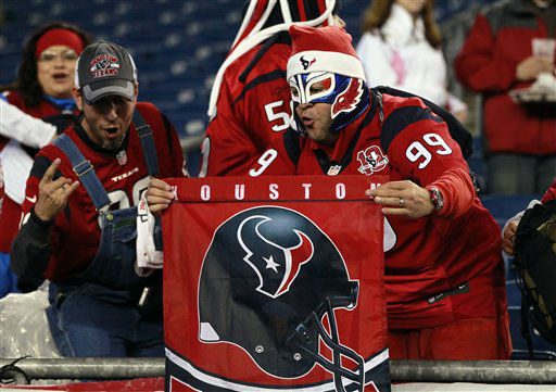 Houston Texans fans cheer for their team before an NFL football game between the Texans and New England Patriots in Foxborough, Mass., Monday, Dec. 10, 2012. &#40;AP Photo&#47;Steven Senne&#41; <span class=meta>(AP Photo&#47; Steven Senne)</span>