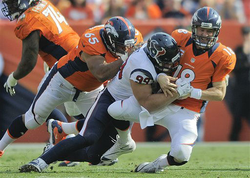 Denver Broncos quarterback Peyton Manning &#40;18&#41; is sacked by Houston Texans defensive end J.J. Watt &#40;99&#41; as guard Manny Ramirez &#40;65&#41; defends in the third quarter of an NFL football game Sunday, Sept. 23, 2012, in Denver. &#40;AP Photo&#47;Jack Dempsey&#41; <span class=meta>(AP Photo&#47; Jack Dempsey)</span>