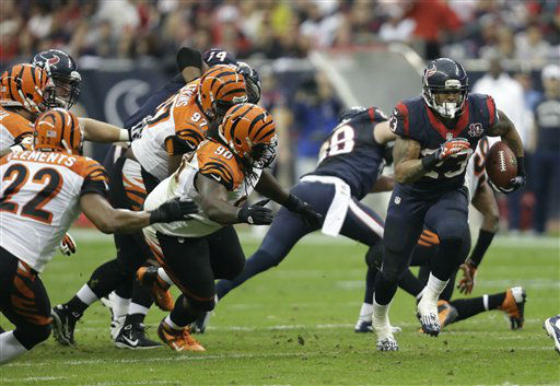 Houston Texans running back Arian Foster &#40;23&#41; runs the ball against the Cincinnati Bengals during the second quarter of an NFL wild card playoff football game Saturday, Jan. 5, 2013, in Houston. &#40;AP Photo&#47;Eric Gay&#41; <span class=meta>(AP Photo&#47; Eric Gay)</span>