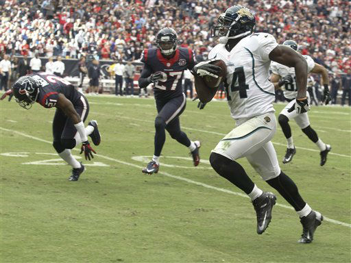 Jacksonville Jaguars&#39; Justin Blackmon &#40;14&#41; scores a touchdown against the Houston Texans during the fourth quarter of an NFL football game Sunday, Nov. 18, 2012, in Houston.   <span class=meta>(AP Photo&#47; Patric Schneider)</span>