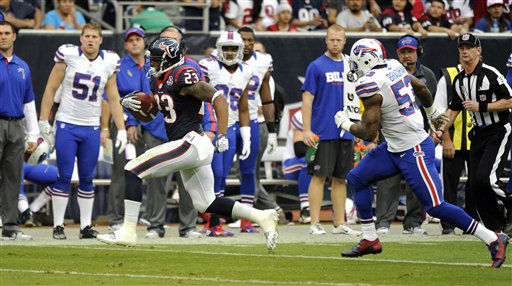 Houston Texans running back Arian Foster &#40;23&#41; rushes for a gain as Buffalo Bills outside linebacker Nigel Bradham &#40;53&#41; pursues in the second quarter of an NFL football game Sunday, Nov. 4, 2012, in Houston. &#40;AP Photo&#47;Dave Einsel&#41; <span class=meta>(AP Photo&#47; Dave Einsel)</span>