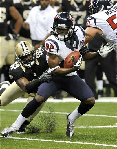 New Orleans Saints defensive end Junior Galette &#40;93&#41; tries to drag down Houston Texans wide receiver Keshawn Martin &#40;82&#41; in the first half of an NFL preseason football game in New Orleans, Saturday, Aug. 25, 2012. &#40;AP Photo&#47;Bill Feig&#41; <span class=meta>(AP Photo&#47; Bill Feig)</span>