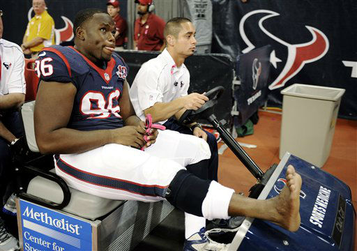 Houston Texans defensive end Tim Jamison &#40;96&#41; is taken off the field in the first quarter of an NFL football game against the Green Bay Packers, Sunday, Oct. 14, 2012, in Houston. &#40;AP Photo&#47;Dave Einsel&#41; <span class=meta>(AP Photo&#47; Dave Einsel)</span>