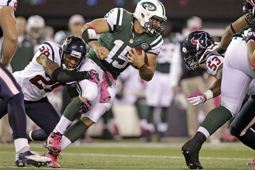 New York Jets quarterback Tim Tebow &#40;15&#41; is tackled by Houston Texans strong safety Glover Quin &#40;29&#41; and teammate  Bradie James &#40;53&#41; during the first half of an NFL football game Monday, Oct. 8, 2012, in East Rutherford, N.J. &#40;AP Photo&#47;Kathy Willens&#41; <span class=meta>(AP Photo&#47; Kathy Willens)</span>