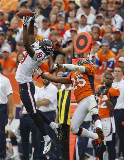Houston Texans wide receiver Lestar Jean &#40;18&#41; leaps to catch a pass against Denver Broncos strong safety Chris Harris &#40;25&#41; in the third quarter of an NFL football game Sunday, Sept. 23, 2012, in Denver. &#40;AP Photo&#47;David Zalubowski&#41; <span class=meta>(AP Photo&#47; David Zalubowski)</span>