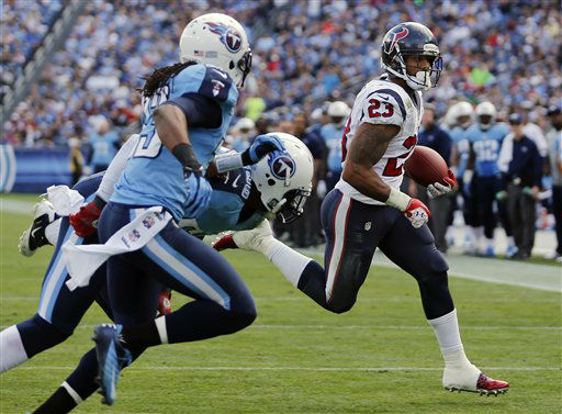 Houston Texans running back Arian Foster &#40;23&#41; scores a touchdown on a 2-yard run as Tennessee Titan defenders Michael Griffin &#40;33&#41; and Akeem Ayers, center, pursue him in the second quarter of an NFL football game on Sunday, Dec. 2, 2012, in Nashville, Tenn. &#40;AP Photo&#47;Joe Howell&#41; <span class=meta>(AP Photo&#47; Joe Howell)</span>