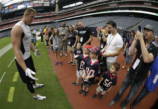 Houston Texans defensive end J.J. Watt, left, greets fans before an NFL football game against the Buffalo Bills Sunday, Nov. 4, 2012, in Houston. &#40;AP Photo&#47;David J. Phillip&#41; <span class=meta>(AP Photo&#47; David J. Phillip)</span>