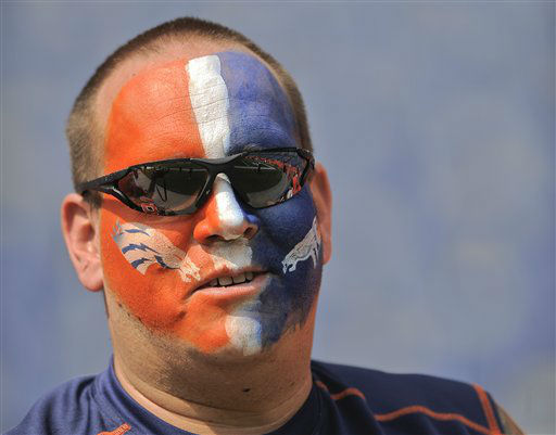 "<div class=""meta ""><span class=""caption-text "">A Denver Broncos fan watches players warm up before an NFL football game against the Houston Texans Sunday, Sept. 23, 2012, in Denver. (AP Photo/Jack Dempsey) (AP Photo/ Jack Dempsey)</span></div>"