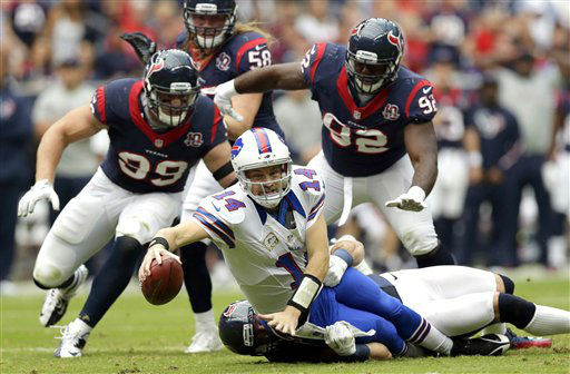 Buffalo Bills quarterback Ryan Fitzpatrick &#40;14&#41; is sacked by Houston Texans outside linebacker Connor Barwin in the second quarter of an NFL game on Sunday, Nov. 4, 2012, in Houston. Texans&#39; J.J. Watt &#40;99&#41;, Earl Mitchell &#40;92&#41; and Brooks Reed &#40;58&#41; also defend. &#40;AP Photo&#47;Eric Gay&#41; <span class=meta>(AP Photo&#47; Eric Gay)</span>