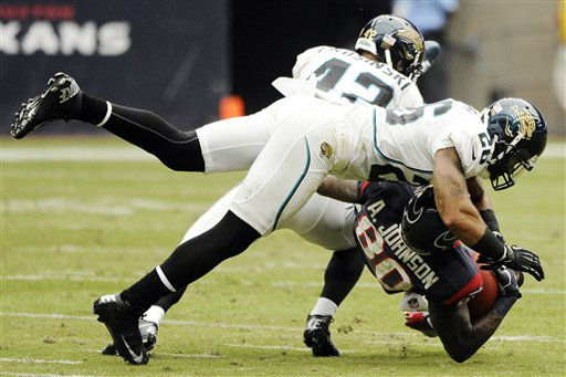 Houston Texans&#39; Andre Johnson &#40;80&#41; is tackled by Jacksonville Jaguars Chris Prosinski &#40;42&#41; and Dawan Landry &#40;26&#41; during the second quarter of an NFL football game, Sunday, Nov. 18, 2012, in Houston.   <span class=meta>(AP Photo&#47; Dave Einsel)</span>
