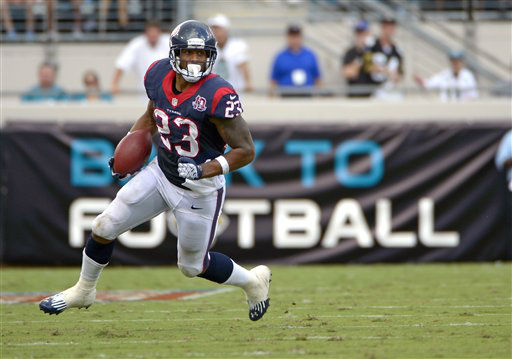 Houston Texans running back Arian Foster &#40;23&#41; gains yardage against the Jacksonville Jaguars during the first half an NFL football game, Sunday, Sept. 16, 2012, in Jacksonville, Fla. &#40;AP Photo&#47;Phelan M. Ebenhack&#41; <span class=meta>(AP Photo&#47; Phelan M. Ebenhack)</span>