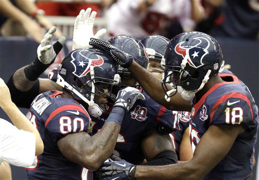 Houston Texans wide receiver Andre Johnson &#40;80&#41; is congratulated by teammates, including Lestar Jean &#40;18&#41;, after catching touchdown pass in the first quarter of an NFL football game against the Indianapolis Colts, Sunday, Dec. 16, 2012, in Houston.  <span class=meta>(AP Photo&#47; Eric Gay)</span>
