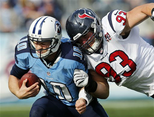 Tennessee Titans quarterback Jake Locker &#40;10&#41; is hit by Houston Texans defensive end Jared Crick &#40;93&#41; in the second quarter of an NFL football game on Sunday, Dec. 2, 2012, in Nashville, Tenn. &#40;AP Photo&#47;Joe Howell&#41; <span class=meta>(AP Photo&#47; Joe Howell)</span>