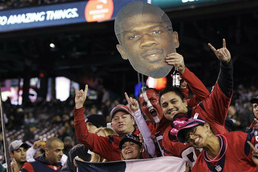 Houston Texans fans cheer while holding up a photo of wide receiver Andre Johnson &#40;80&#41;before an NFL football game between the New York Jets and the Houston Texans Monday, Oct. 8, 2012, in East Rutherford, N.J. &#40;AP Photo&#47;Kathy Willens&#41; <span class=meta>(AP Photo&#47; Kathy Willens)</span>