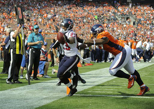 Houston Texans running back Arian Foster &#40;23&#41; scores a touchdown against Denver Broncos defensive tackle Kevin Vickerson &#40;99&#41; in the first quarter of an NFL football game Sunday, Sept. 23, 2012, in Denver. &#40;AP Photo&#47;Jack Dempsey&#41; <span class=meta>(AP Photo&#47; Jack Dempsey)</span>