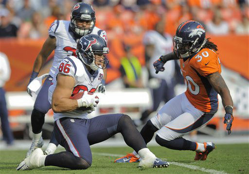 Houston Texans fullback James Casey &#40;86&#41; recovers an onside kick as Denver Broncos free safety David Bruton &#40;30&#41; defends in the third quarter of an NFL football game Sunday, Sept. 23, 2012, in Denver. &#40;AP Photo&#47;Jack Dempsey&#41; <span class=meta>(AP Photo&#47; Jack Dempsey)</span>