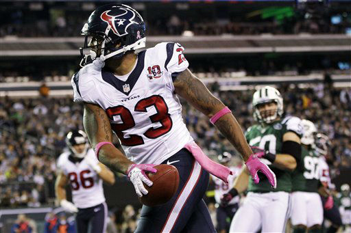 Houston Texans running back Arian Foster &#40;23&#41; celebrates after rushing for a touchdown during the first half of an NFL football game against the New York Jets, Monday, Oct. 8, 2012, in East Rutherford, N.J. &#40;AP Photo&#47;Kathy Willens&#41; <span class=meta>(AP Photo&#47; Kathy Willens)</span>