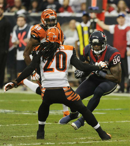 "<div class=""meta ""><span class=""caption-text "">Houston Texans wide receiver Andre Johnson (80) makes a reception as Cincinnati Bengals free safety Reggie Nelson (20) defends during the first quarter of an NFL wild card playoff football game Saturday, Jan. 5, 2013, in Houston. (AP Photo/Dave Einsel) (AP Photo/ Dave Einsel)</span></div>"