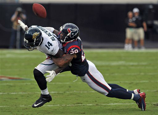 Houston Texans strong safety Glover Quin &#40;29&#41; breaks up a pass intended for Jacksonville Jaguars wide receiver Justin Blackmon &#40;14&#41; during the first half an NFL football game on Sunday, Sept. 16, 2012, in Jacksonville, Fla. &#40;AP Photo&#47;Stephen Morton&#41; <span class=meta>(AP Photo&#47; Stephen Morton)</span>