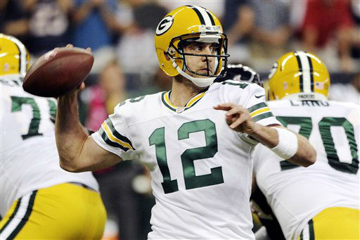 Green Bay Packers quarterback Aaron Rodgers &#40;12&#41; throws against the Houston Texans in the first quarter of an NFL football game, Sunday, Oct. 14, 2012, in Houston. &#40;AP Photo&#47;Dave Einsel&#41; <span class=meta>(AP Photo&#47; Dave Einsel)</span>