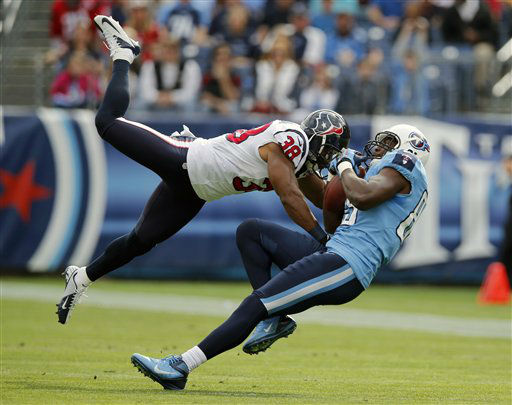 Tennessee Titans tight end Jared Cook, right, catches a pass as he is defended by Houston Texans free safety Danieal Manning &#40;38&#41; in the first quarter of an NFL football game on Sunday, Dec. 2, 2012, in Nashville, Tenn.   <span class=meta>(AP Photo&#47; Joe Howell)</span>