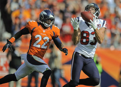 Houston Texans wide receiver Kevin Walter &#40;83&#41; catches a pass against Denver Broncos cornerback Tracy Porter &#40;22&#41; for a touchdown in the second quarter of an NFL football game Sunday, Sept. 23, 2012, in Denver. &#40;AP Photo&#47;Jack Dempsey&#41; <span class=meta>(AP Photo&#47; Jack Dempsey)</span>