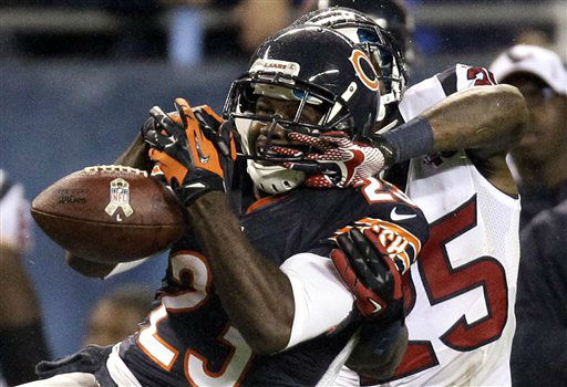 Chicago Bears wide receiver Devin Hester &#40;23&#41; misses a catch while under pressure from Houston Texans cornerback Kareem Jackson &#40;25&#41; in the first half an NFL football game, Sunday, Nov. 11, 2012, in Chicago. &#40;AP Photo&#47;Nam Y. Huh&#41; <span class=meta>(AP Photo&#47; Nam Y. Huh)</span>