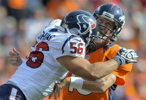 Denver Broncos quarterback Peyton Manning &#40;18&#41; is hit by Houston Texans inside linebacker Brian Cushing &#40;56&#41; in the second quarter of an NFL football game Sunday, Sept. 23, 2012, in Denver. &#40;AP Photo&#47;Jack Dempsey&#41; <span class=meta>(AP Photo&#47; Jack Dempsey)</span>