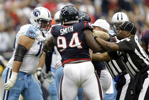 Officials break up a skirmish between players including Tennessee Titans&#39; David Stewart, left, and Houston Texans&#39; Antonio Smith &#40;94&#41; in the second quarter of an NFL football game Sunday, Sept. 30, 2012, in Houston. &#40;AP Photo&#47;Eric Gay&#41; <span class=meta>(AP Photo&#47; Eric Gay)</span>