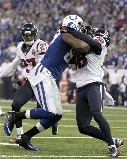 "<div class=""meta ""><span class=""caption-text "">Indianapolis Colts' Dwayne Allen (83) is tackled by Houston Texans' Danieal Manning (38) during the first half of an NFL football game on Sunday, Dec. 30, 2012, in Indianapolis. (AP Photo/AJ Mast) (AP Photo/ AJ Mast)</span></div>"