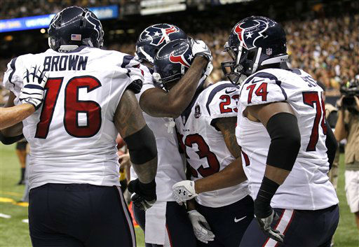 Houston Texans running back Arian Foster &#40;23&#41; celebrates a rushing touchdown in the first half of an NFL preseason football game against the New Orleans Saints in New Orleans, Saturday, Aug. 25, 2012. &#40;AP Photo&#47;Bill Haber&#41; <span class=meta>(AP Photo&#47; Bill Haber)</span>