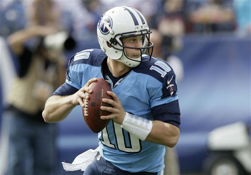 Tennessee Titans quarterback Jake Locker rolls out against the Houston Texans in the first quarter of an NFL football game on Sunday, Dec. 2, 2012, in Nashville, Tenn.   <span class=meta>(AP Photo&#47; Wade Payne)</span>