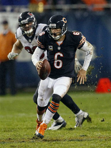 Chicago Bears quarterback Jay Cutler &#40;6&#41; scrambles away from a Houston Texans defender in the first half an NFL football game, Sunday, Nov. 11, 2012, in Chicago. &#40;AP Photo&#47;Charles Rex Arbogast&#41; <span class=meta>(AP Photo&#47; Charles Rex Arbogast)</span>