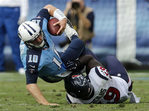 Tennessee Titans quarterback Jake Locker &#40;10&#41; is sacked for a 1-yard loss by Houston Texans linebacker Whitney Mercilus &#40;59&#41; in the second quarter of an NFL football game on Sunday, Dec. 2, 2012, in Nashville, Tenn. &#40;AP Photo&#47;Joe Howell&#41; <span class=meta>(AP Photo&#47; Joe Howell)</span>
