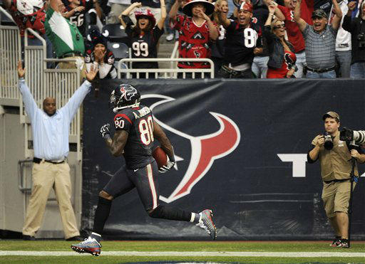 Houston Texans wide receiver Andre Johnson scores the winning touchdown against the Jacksonville Jaguars in overtime of an NFL football game Sunday, Nov. 18, 2012, in Houston. The Texans won 43-37.   <span class=meta>(AP Photo&#47; Dave Einsel)</span>