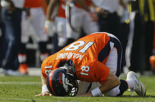 Denver Broncos quarterback Peyton Manning &#40;18&#41; gets up off the turf after taking a hit by the Houston Texans in the second quarter of an NFL football game Sunday, Sept. 23, 2012, in Denver. &#40;AP Photo&#47;David Zalubowski&#41; <span class=meta>(AP Photo&#47; David Zalubowski)</span>