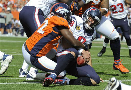 Houston Texans quarterback Matt Schaub &#40;8&#41; is sacked in the end zone for a safety by Denver Broncos defensive end Elvis Dumervil &#40;92&#41; during the first quarter of an NFL football game Sunday, Sept. 23, 2012, in Denver. &#40;AP Photo&#47;Jack Dempsey&#41; <span class=meta>(AP Photo&#47; Jack Dempsey)</span>