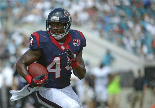 Houston Texans running back Ben Tate gains yardage against the Jacksonville Jaguars during the first half an NFL football game, Sunday, Sept. 16, 2012, in Jacksonville, Fla. &#40;AP Photo&#47;Phelan M. Ebenhack&#41; <span class=meta>(AP Photo&#47; Phelan M. Ebenhack)</span>
