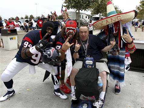 Houston Texans fans mug for the camera outside Reliant Stadium before an NFL football game between the Houston Texans and the Tennessee Titans Sunday, Sept. 30, 2012, in Houston. &#40;AP Photo&#47;Patric Schneider&#41; <span class=meta>(AP Photo&#47; Patric Schneider)</span>