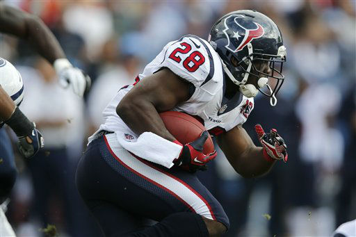 Houston Texans running back Justin Forsett runs against the Tennessee Titans in the first quarter of an NFL football game on Sunday, Dec. 2, 2012, in Nashville, Tenn. (AP Photo/Joe Howell)