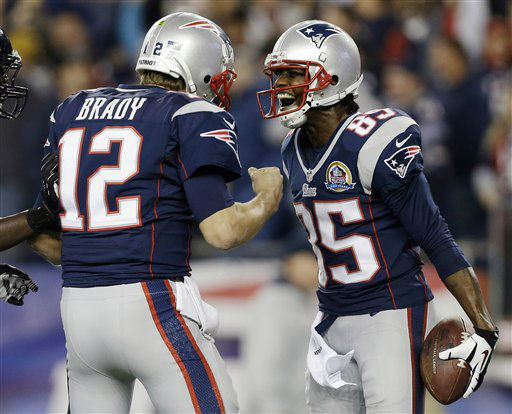 "<div class=""meta image-caption""><div class=""origin-logo origin-image ""><span></span></div><span class=""caption-text"">New England Patriots quarterback Tom Brady (12) celebrates his 37-yard touchdown pass to wide receiver Brandon Lloyd (85) during the first quarter of an NFL football game against the Houston Texans in Foxborough, Mass., Monday, Dec. 10, 2012. (AP Photo/Elise Amendola) (AP Photo/ Elise Amendola)</span></div>"