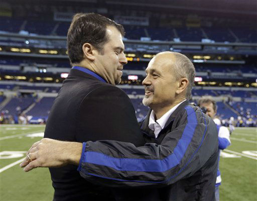 Indianapolis Colts head coach Chuck Pagano, right, is hugged by general manager Ryan Grigson after he walks onto the field before an NFL football game against the Houston Texans, Sunday, Dec. 30, 2012, in Indianapolis. (AP Photo/Michael Conroy)
