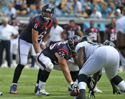 Houston Texans quarterback Matt Schaub &#40;8&#41; lines up behind center Chris Myers &#40;55&#41; for a play against the Jacksonville Jaguars during the first half an NFL football game, Sunday, Sept. 16, 2012, in Jacksonville, Fla. &#40;AP Photo&#47;Stephen Morton&#41; <span class=meta>(AP Photo&#47; Stephen Morton)</span>