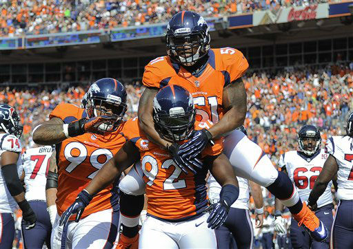 Denver Broncos middle linebacker Joe Mays &#40;51&#41; and defensive tackle Kevin Vickerson &#40;99&#41; celebrate with defensive end Elvis Dumervil &#40;92&#41; after Dumervil sacked Houston Texans quarterback Matt Schaub &#40;8&#41; in the end zone for a safety during the first quarter of an NFL football game Sunday, Sept. 23, 2012, in Denver. &#40;AP Photo&#47;Jack Dempsey&#41; <span class=meta>(AP Photo&#47; Jack Dempsey)</span>