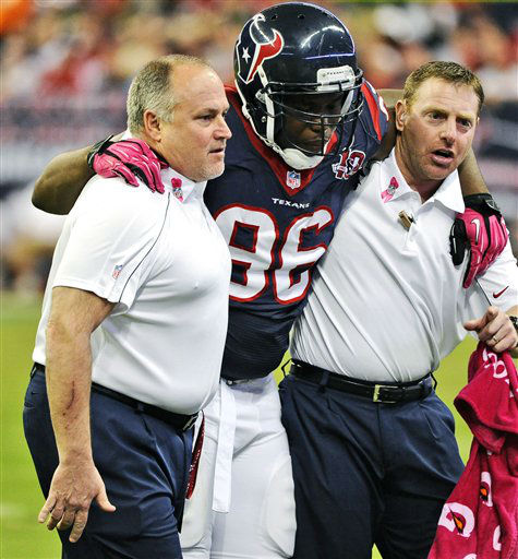 Houston Texans defensive end Tim Jamison &#40;96&#41; is helped off the field in the first quarter of an NFL football game against the Green Bay Packers, Sunday, Oct. 14, 2012, in Houston. &#40;AP Photo&#47;Dave Einsel&#41; <span class=meta>(AP Photo&#47; Dave Einsel)</span>